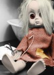 creepy_doll_by_goingforthegold