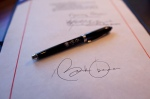 close-up-detail-of-president-obamas-signature-on-a-bill-and-a-pen-used-for-the-signing-aboard-air-force-one
