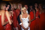 The siblings pose with models during the showing of their 1995-1996 couture collection